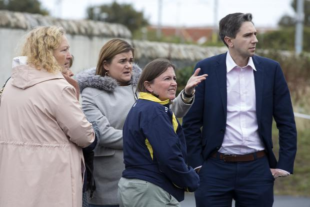 Minister Simon Harris with Cllr Irene Winters, Anne King and Marian O'Rourke at the scene on Friday