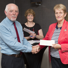 James Kenna presents a cheque to Barbara Davis on behalf of Charabanc.