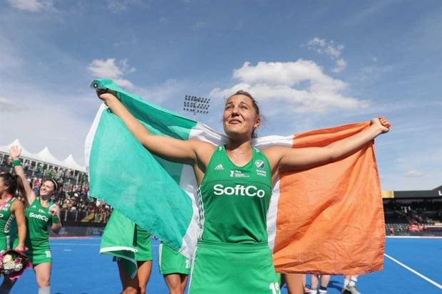 Elena proudly wraps the Irish flag around her at the Women's Hockey World Cup.