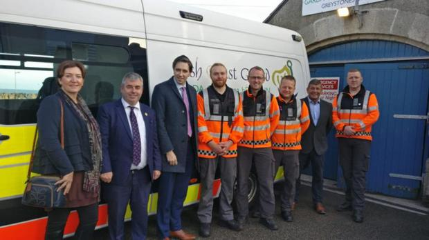 Ministers Simon Harris and Andrew Doyle with Minister Kevin Boxer Moran, Fine Gael representative Alice O'Donnell and members of the Coast Guard outside the current station