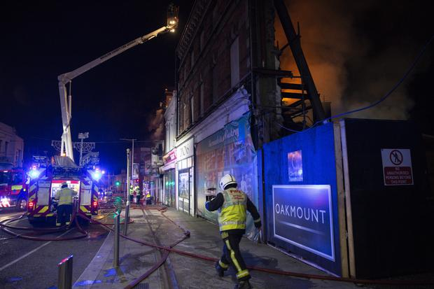 Firefighters tackling the fire at the Florentine Bar, Hilton's Pharmacy and the offices of Maguire McNiece solicitors