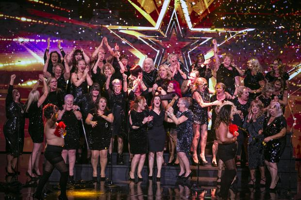 The Sea of Change Choir celebrate after Denise van Outen hit the golden buzzer to send them straight through to the live semi-finals of Ireland's Got Talent.