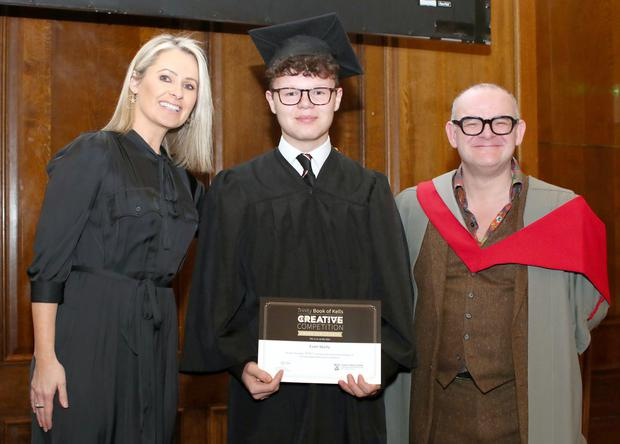 Evan Skelly from Woodbrook College with RTE news anchor and presenter Sharon Ni Bheoláin and Professor Darryl Jones, Dean of the Faculty of Arts, Humanities and Social Sciences