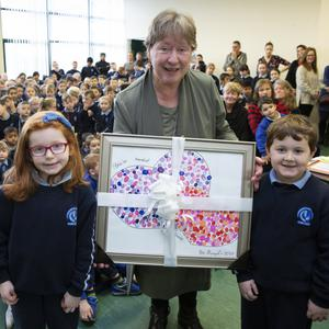 Isabelle Bolton and Charlie Stapleton Farrington make a presentation to Mary Loftus from the whole school as she retires from St Fergal's NS in Bray. Photos: Barbara Flynn