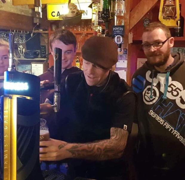 Keith Flint pouring a pint of the black stuff during his visit to Black Tom's in Tinahely last September