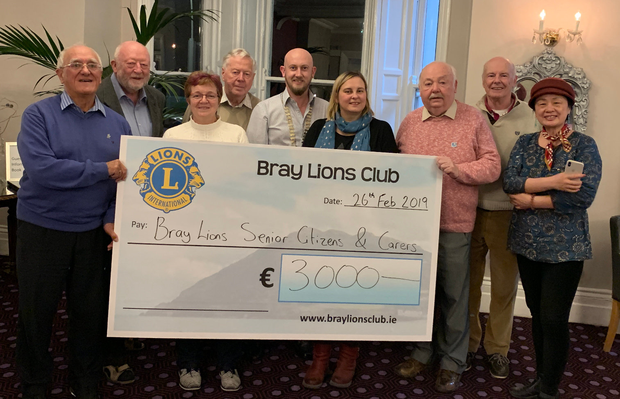 Frank Corr, John McEvoy, Anne Blount, Norman Heagney, Karl O'Broin (President), Gillian Heath, Danny Bohan, Ray McDonagh and Shu Rong at presentation of a cheque for €3,000 to Bray Lions Senior Citizens/Carers Funds