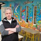 Kieron White with his mural at the Little Bray Community Centre.