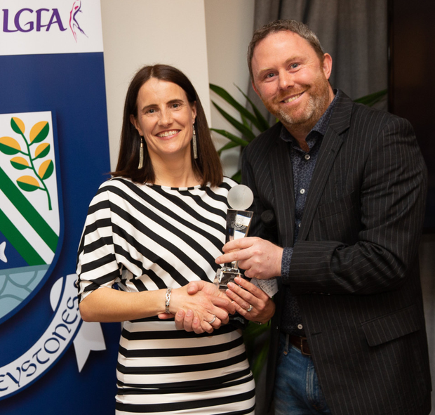 Ciaran Goff presents Camogie Clubwoman award to Christina Earls