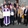 Family watch on as James Byrne is presented with a Benemerenti Medal for his services to the Catholic Church by his nephew Fr Richard Byrne and Fr John Wall at Curtlestown Church