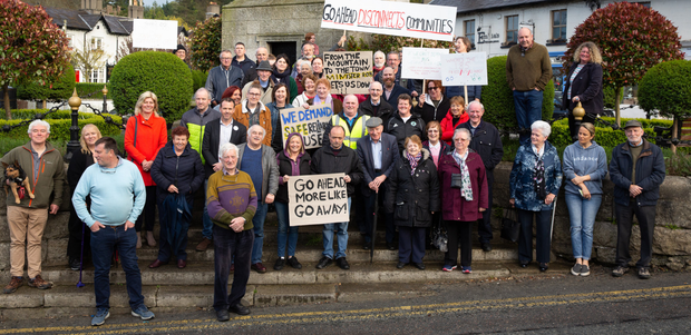 Local residents and local representatives gather at the clock tower in Enniskerry to express their dissatisfaction with the service provided by Go Ahead since it took over the 185 bus route