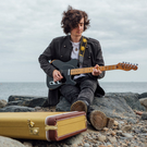 Greystones songwriter and musician Dylan E Crampton at Greystones beach. Photo by Sam Donohue