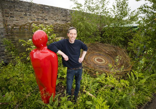 Rúaidhrí Bashford in his 'Moving Forward – Building My Best Possible Life' garden, sponsored by Cheshire Ireland