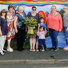 The artists in front of their new mural in Roundwood, which was organised by Roundwood Tidy Towns and Roundwood Community Council: (from left) Fr Owen Lynch PP, Dominique Schefman, Eithne Kavanagh, Noreen Keane, Eleanor Fanning, Mary Fanning, Aoife Patterson, Hiudai and Finnan Reid, Libby Bennett, Ellie Ginty and Fiona Tuite