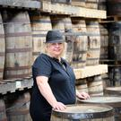 Author Kate Amber among the whiskey barrels at the Powerscourt Distillery