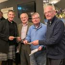 Rev Cathy Hallissey, Rector of Powerscourt Parish; John Foster ,Treasurer; John Prosser, Chairman of the Joint Parishes; and Fr Bernard Kennedy from St Mary's Parish Church, Enniskerry, at the presentation of the proceeds from the Enniskerry Joint Parishes Golf Classic