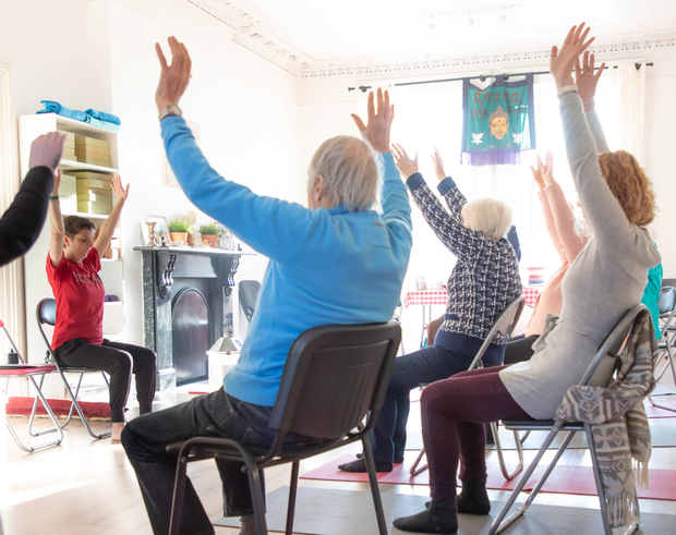 Louise Curran leading a chair yoga session at Árus Lorcáin in Arklow