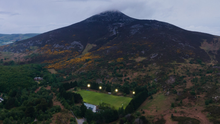 The stunning setting of the Kilmacanogue GAA Club grounds in the shadow of the Sugarloaf on the evening their new lights were turned on for the first time. Photos by Aerial Media 360 (Aidan O'Toole)