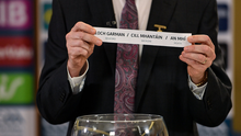 Chairman of the Leinster Council of the GAA Pat Teehan draws the names Wexford/Wicklow/Meath for their round during the Leinster hurling and football championship draws
