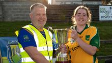 Wicklow Camogie Chairman Ivor Lehane presents Katie Daynes with the Senior championship cup in Dunbur Park last year