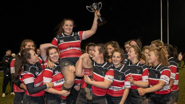 Wicklow RFC captain Amy O'Neill is lifted high by her team mates in Ashtown Lane