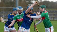 Wicklow's Martin O'Brien looks to make headway up the field as the Mayo forwards press hard