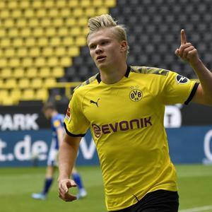 Erling Haaland celebrates in front of empty stands after scoring for Borussia Dortmund in their 4-0 win over Schalke on Saturday