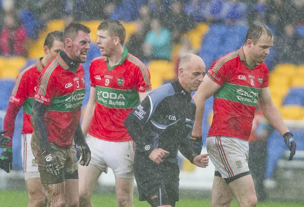 The evil eye - Rathnew's Damien Power clearly disagrees with a decision made by Cormac Reilly