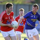 Louth's Daniel McConnell is tracked by Wicklow's Conor Doyle during the Leinster Junior football championship in Aughrim. Picture: Garry O'Neill