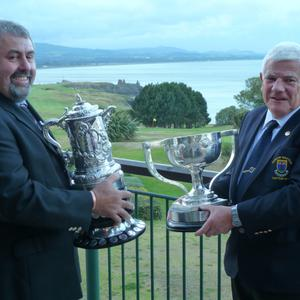 Larry Byrne, President of Wicklow RFC and Declan Long, Captain of Wicklow Golf Club with the Rugby and Golf Provincial Towns Cups at Wicklow Golf Club last weekend
