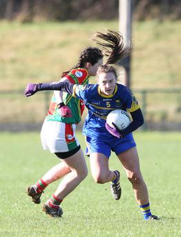 Wicklow's Jessie Byrne goes past Carlow's Sinead Ruth