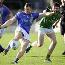 Wicklow's Dean Healy launches a shot towards the Leitrim posts