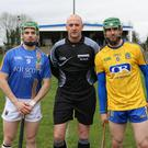 Wicklow captain Christy Moorehouse with his Roscommon counterpart Peter Kellehan and referee Joe Larkin