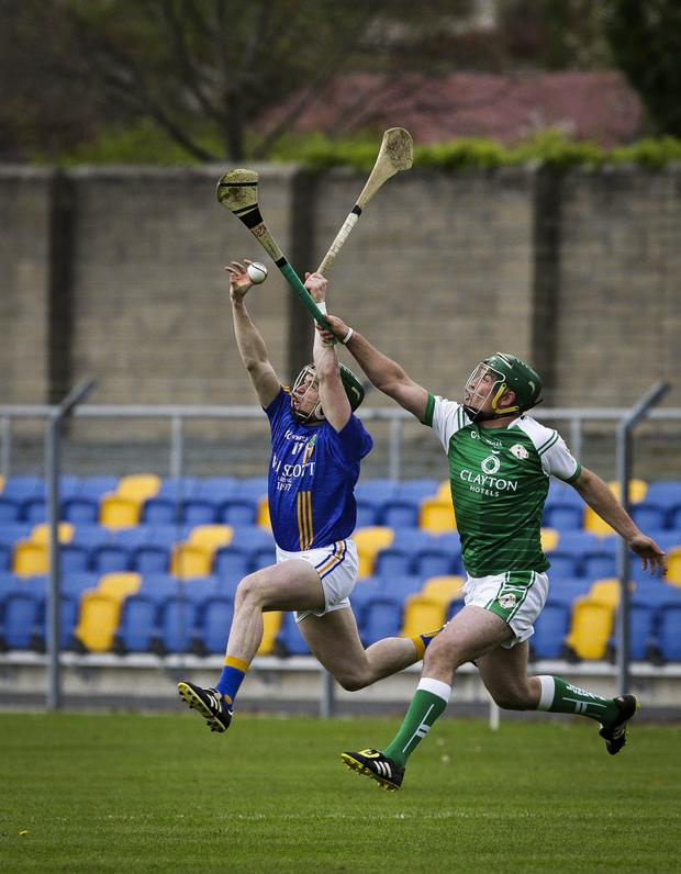 Wicklow's Christy Moorehouse and London's Stephen Bardon compete for a high ball during the Christy Ring Cup