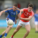 Seánie Furlong of Wicklow in action against Patrick Reilly, left, and Darren McMahon of Louth.
