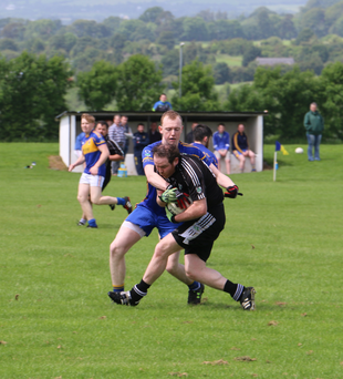 Carnew's John Walshe challenges Newtown's Cathal McNicholas