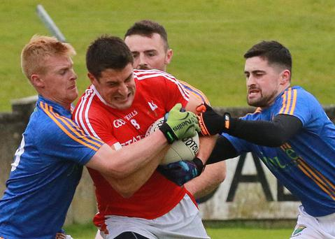 John Manley and Eddie Doyle join forces to stop Louth's Robert Brodigan