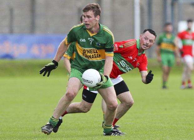 Annacurra's Paul McDonald looks for options as Rathnew's Gary Byrne closes in during the SFC