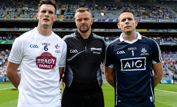 Referee Anthony Nolan with team captains Eoin Doyle of Kildare, left, and Stephen Cluxton