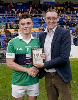 Man of the match David Maloney collects the Wicklow People sponsored award from Brendan Lawrence.