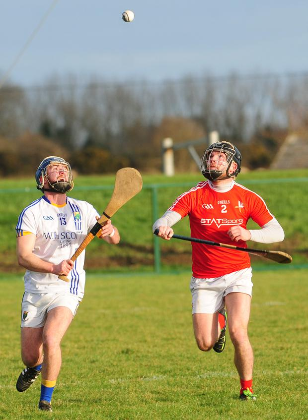 Wicklow's James Cranley and Louth's Stephen Kettle in action