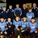 The Michael Dwyers Féile team with Pat Brennan, Brian Keogh, Peter Byrne and special guest Derek McGrath