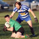 Hollywood's Kevin Cullen under pressure from Michael McLoughlin.