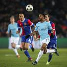 Raheem Sterling of Manchester City keeps his eyes on the ball during their hammering of Basel.