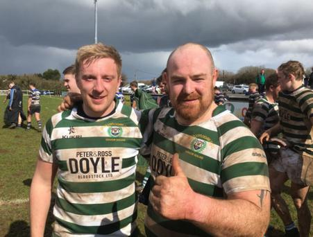 Greystones captain Andrew Kealy with Bobby Clancy after the superb victory in Galway.