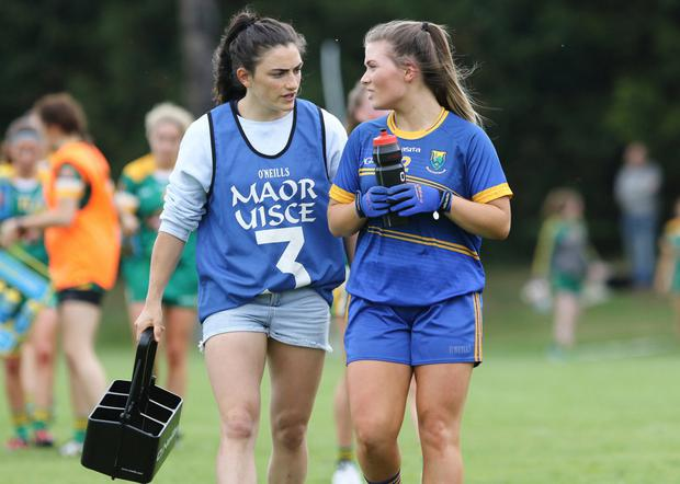 International Rugby Sevens star and Maor Uisce Lucy Mulhall gives some words of advice to her sister Emily at half-time in Roundwood.
