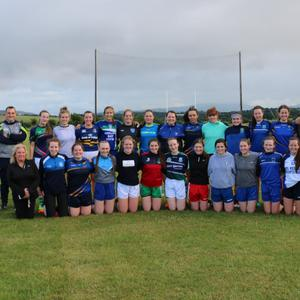 Wicklow People Sports Editor Brendan Lawrence (far left) with the Wicklow Minor footballers and management at their recent training in Ballinakil