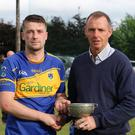 Carnew Emmets captain Wayne Kinsella accepts the cup from County Chairman Martin Fitzgerald