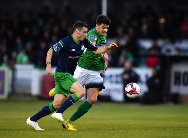 Joel Coustrain of Shamrock Rovers in action against Darragh Noone of Bray Wanderers.