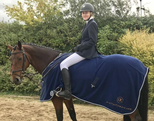 Harriet Bernon with Miss Poppins wearing one of the winning rugs which were sponsored by O'Reilly's fine art Auction Rooms.