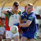 AGB's Darragh Fitzgerald puts pressure on Colm Keogh.